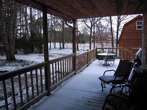 This is taken right from the door way - the wind was blowing all durning the night so we have a snow covered porch.  It is only 23 degrees outside right now compared to the 54 for a high yesterday.