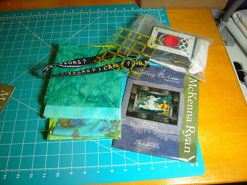 "prize #1 included 20 light aqua hoffman batik 6"" squares,  20 dark aqua hoffman batik 6"" squares, a McKenna Ryan pattern and the other things in the photo."