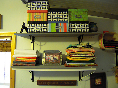 the boxes on the top shelve still contane all the scraps, these consist of strips, patches, bits and pieces of all small sizes - big enough to use in scrap quilts.  Most are pressed and folded neatly (most).  The lower shelve has yardage in about 1 yard to 3 yards each.
