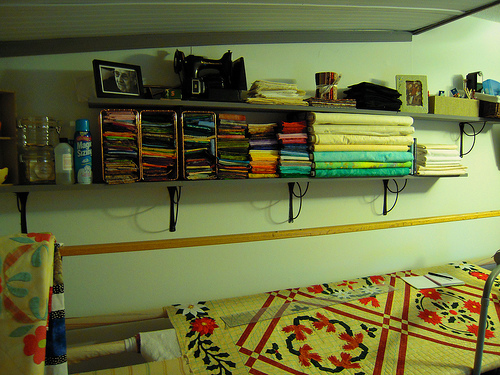 the whole shelf on one side of the room.  The bolts on the end are leftovers from the Dutch Treat quilt in the aqua shades, the beiges/whites are for specific projects for background.  The second dear jane quilt, Little Brown Bird, Red and Green Appliuqe and the Star Crazy quilt.  I like to get the background all at once and normally in 10 to 12 yards so I have enough for the whole quilt without running out as these quilts usually take a year or longer to complete and I don't want to have to try to find it later if I do run out.