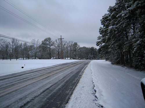 the road in front of our house - a slushy mess right now, tonight down to 14 or lower - it will be all ice tomorrow.